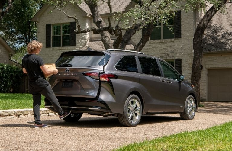 2021 Toyota Sienna with man loading cargo