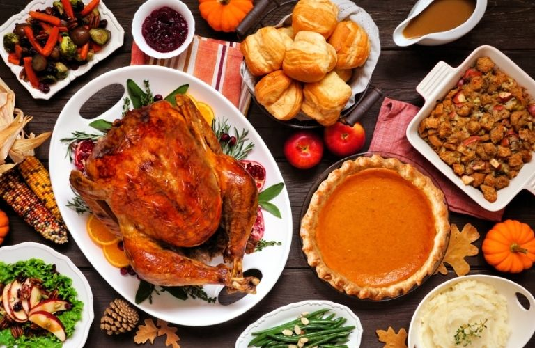 Thanksgiving food set on the table viewed from the top