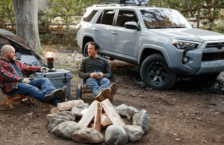 two campers sitting next to 2021 Toyota 4Runner Trail Special Edition