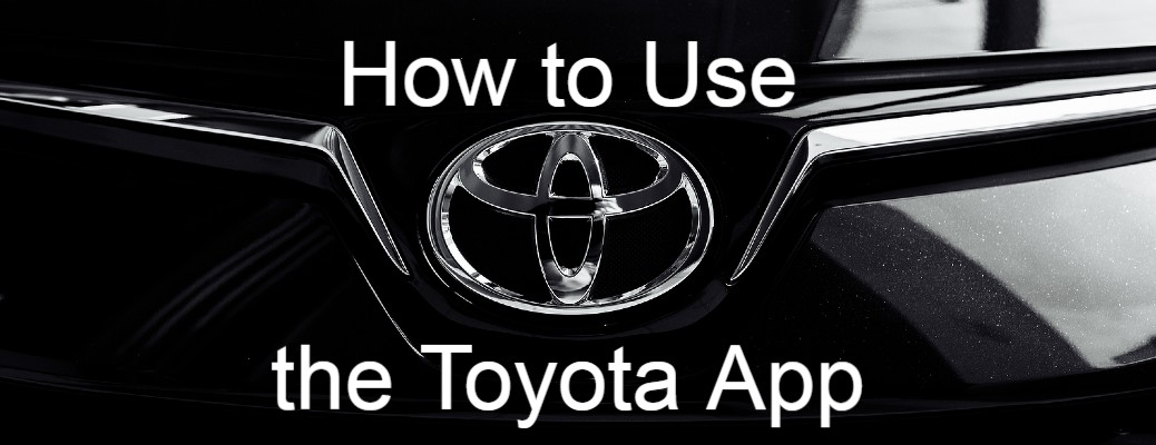 "The Toyota logo on a car with ""How TO Use the Toyota App"" written"