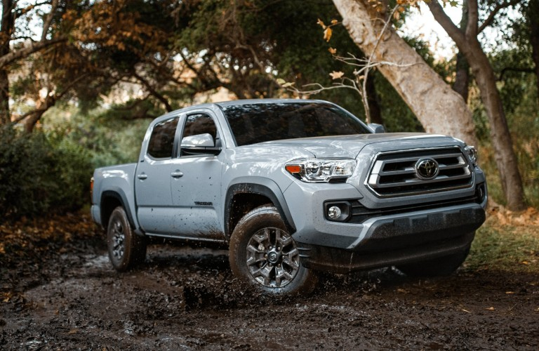 A 2021 Toyota Tacoma parked in the woods