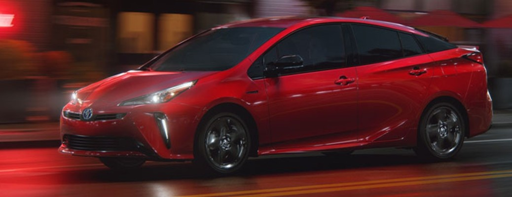 A red-colored 2021 Toyota Prius
