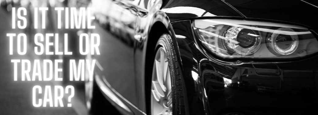 Black and White Photo of Black Car with White Is it Time to Sell or Trade My Car? Text