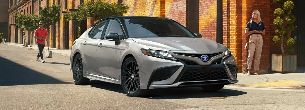 Front passenger angle of a silver 2022 Toyota Camry Hybrid