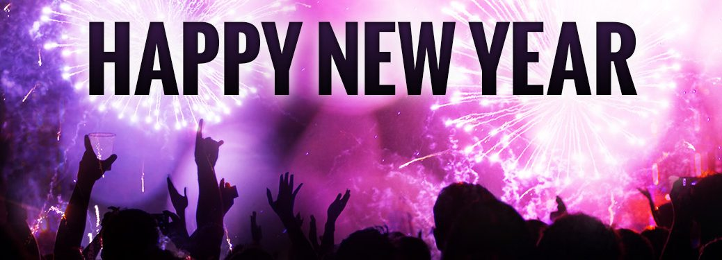 People Silhouetted Against Purple and Pink Fireworks with Black Happy New Year Text