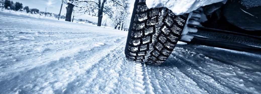 Close Up of Winter Tires on a Snowy Road