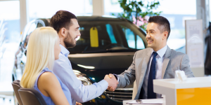 Salesman closing a purchase with clients
