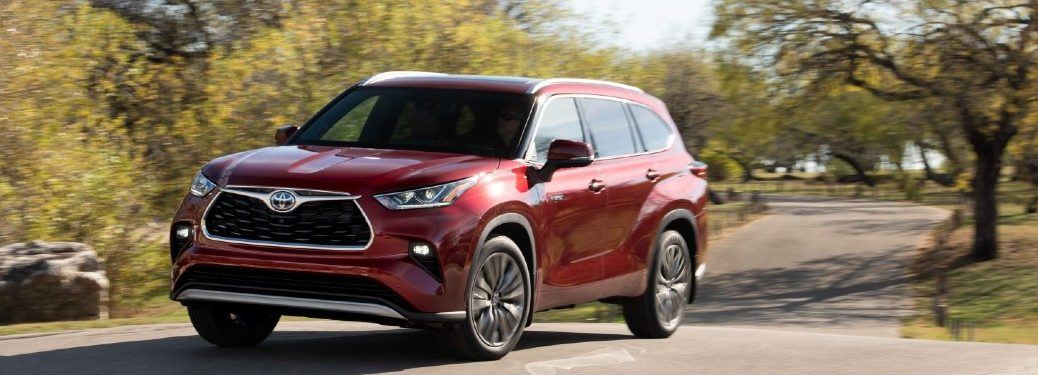 side view of a red 2021 Toyota Highlander Hybrid
