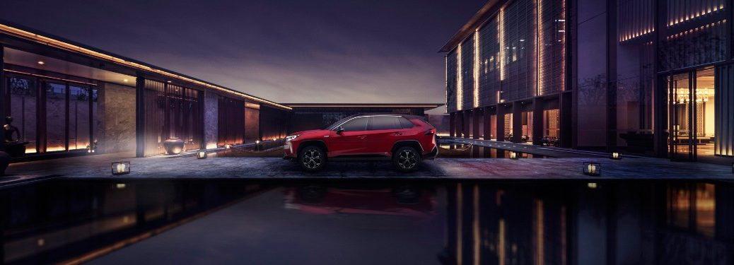 side view of a red 2021 Toyota RAV4 Prime