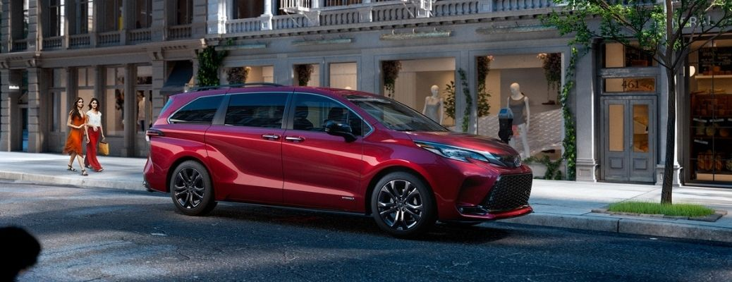 2021 Toyota Sienna Ruby Flare Pearl parked on the side of the road during daytime
