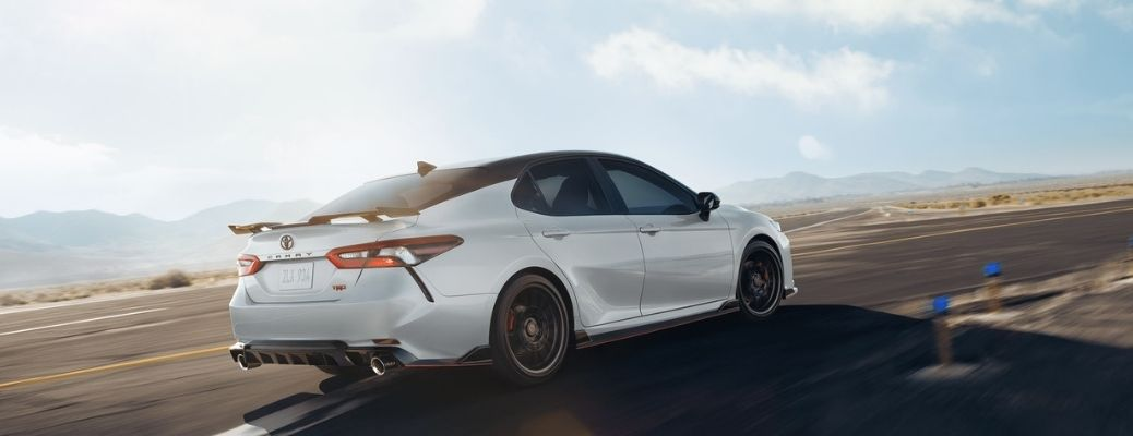 2021 Toyota Camry Super White moving on the road