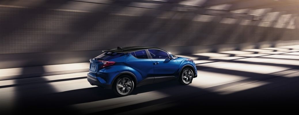 2021 Toyota C-HR Blue Eclipse Metallic with black roof moving on the road