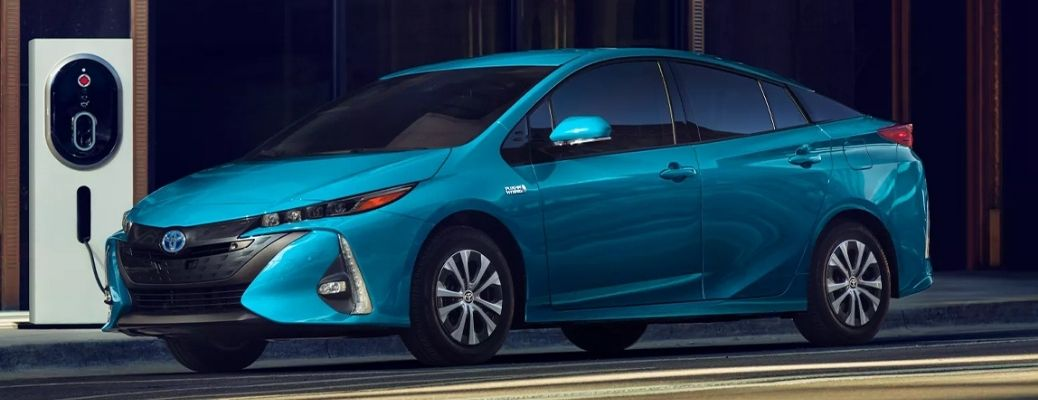 Image of the 2022 Toyota Prius Prime at rest by the side of a road