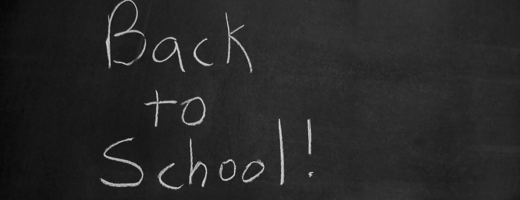 """A blackboard with the words """"Back to School"""" written over it"""
