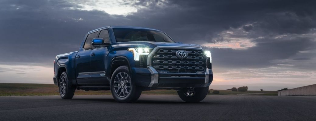 The 2022 Toyota Tundra parked on an empty land against the backdrop of a beautiful sky