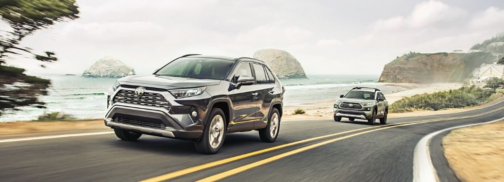 2020 RAV4 Limited and Adventure driving down road with water and rocks from exterior front drivers side