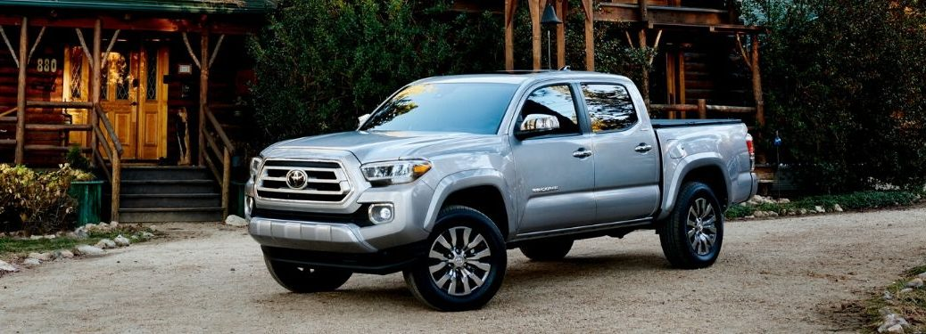 2020 Toyota Tacoma parked in front of cabin