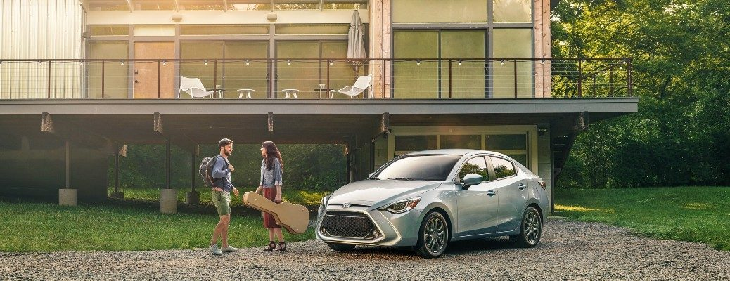 2020 Toyota Yaris gray parked in front of house on gravel