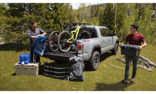 2020 Toyota Tacoma TRD grey with bikes in back and bed extender on ground