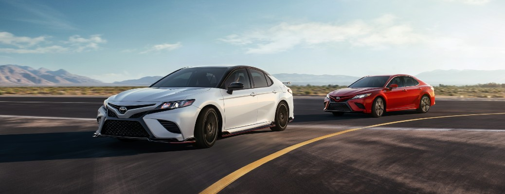 2020 Toyota Camry white and red driving around corner on asphalt