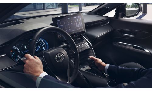 2021 Toyota Venza interior showing man in suit driving