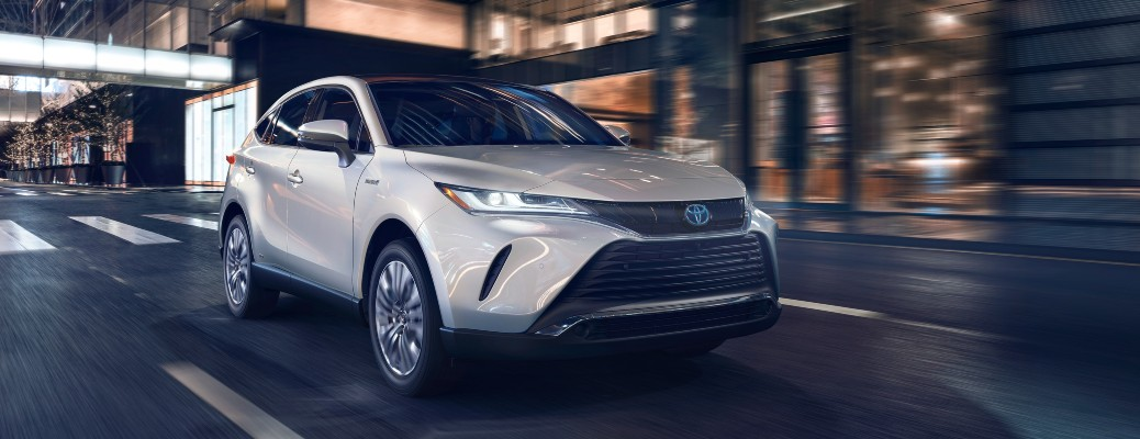2021 Toyota Venza silver white driving down city road showing front and passenger side