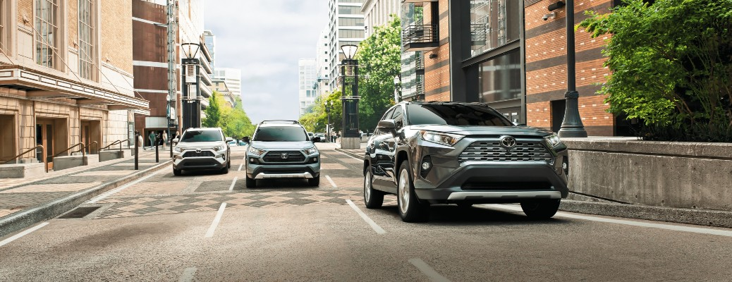 2020 Toyota RAV4 three models driving down road toward shot
