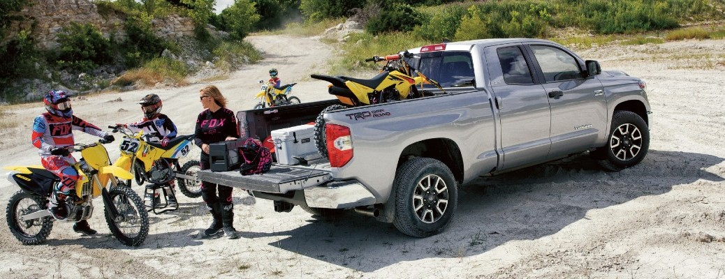 2020 Toyota Tundra exterior shot showing family and dirt bikes on sand