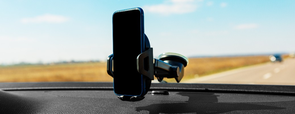 stock photo of phone holder attached to windshield in car