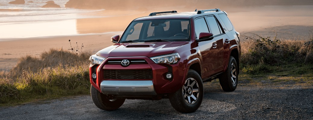 2021 Toyota 4Runner red parked on gravel by shore