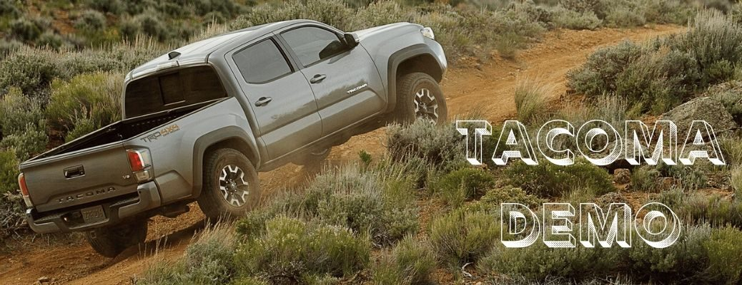 2020 Toyota Tacoma climbing hill with Tacoma Demo text