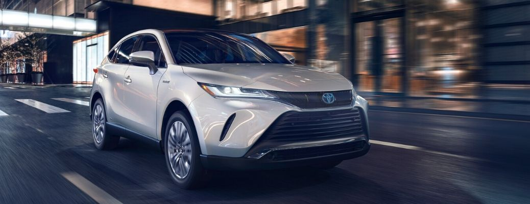 2021 Toyota Venza driving down a road at night