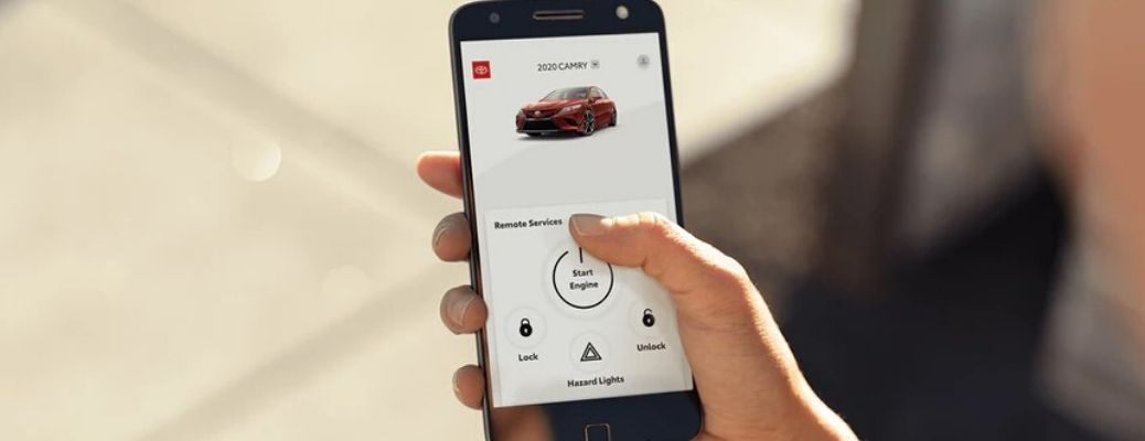 smartphone with the Toyota App displayed on the screen as someone holds it in their hand