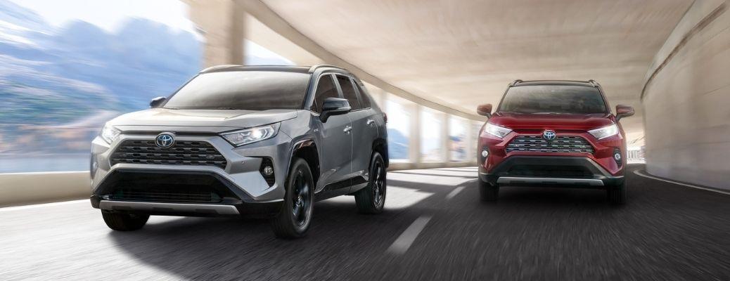 2021 Toyota RAV4 models driving on highway
