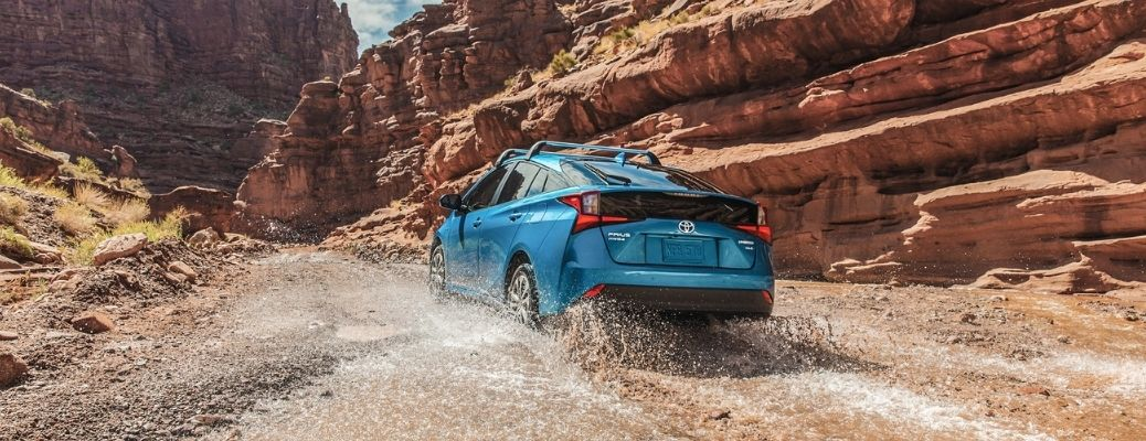 2021 Toyota Prius driving through a puddle