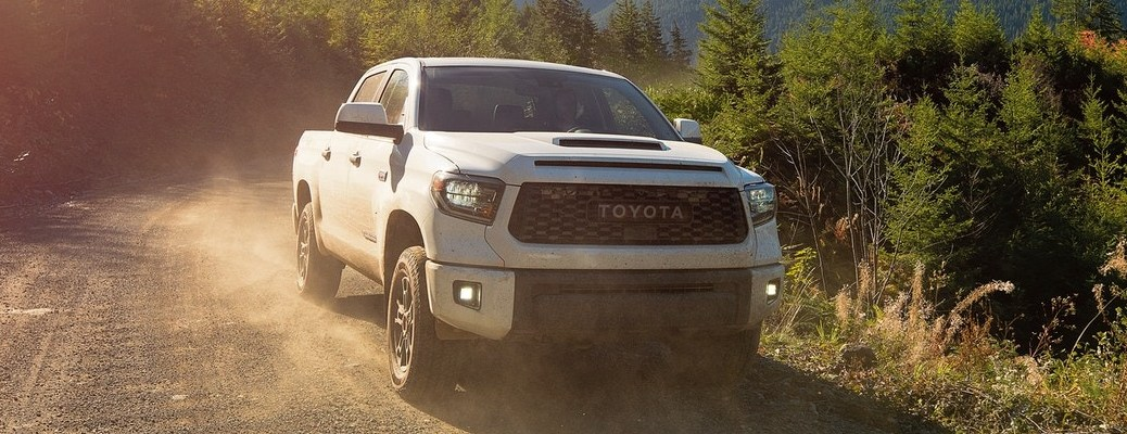 2021 Toyota Tundra going down a dirt road