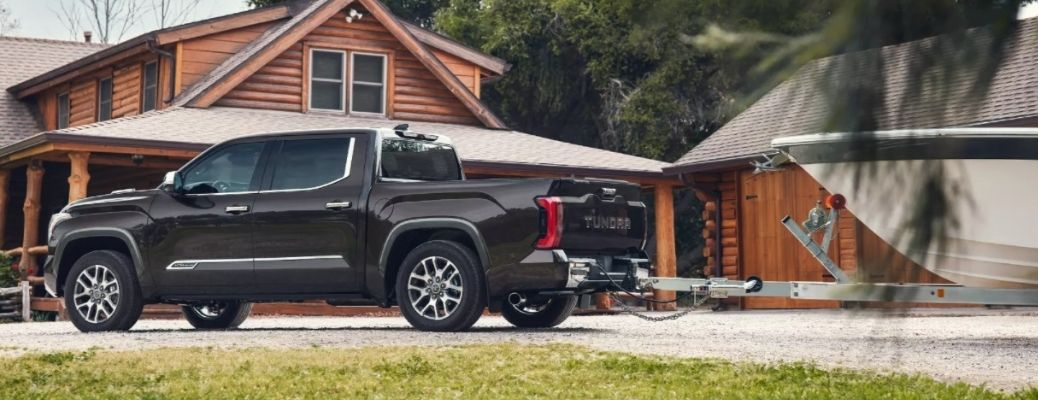 2022 Toyota Tundra and trailer parked outside house