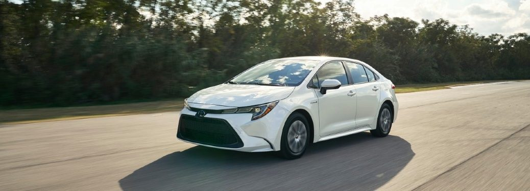 2020 toyota corolla driving down a road