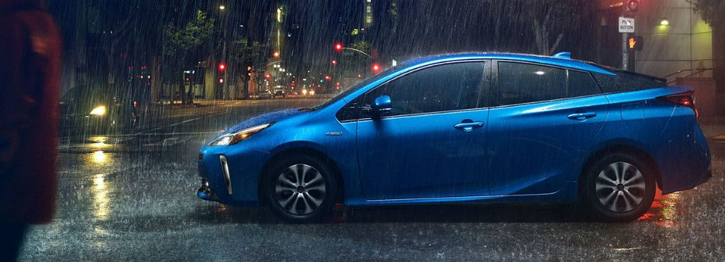2020 Toyota Prius blue exterior driver side driving in rain