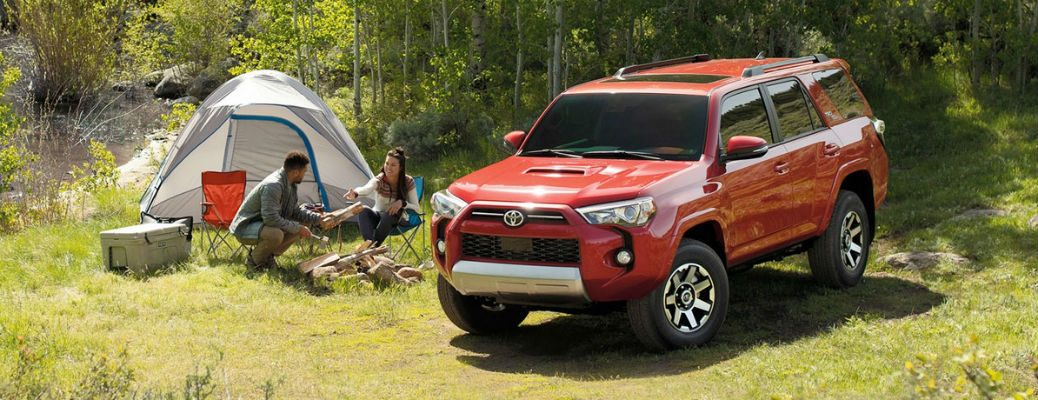 2020 Toyota 4Runner red exterior front fascia driver side parked couple and tent on passenger side