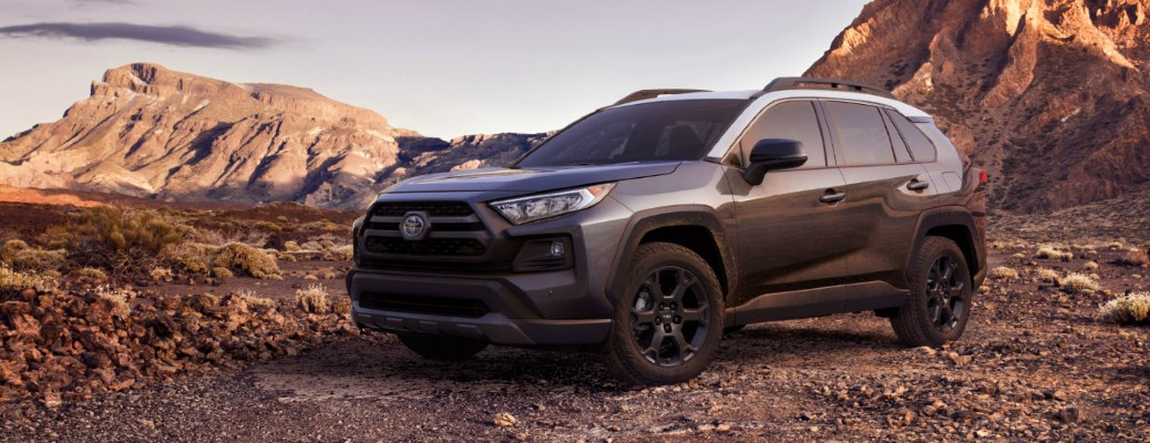 A black 2020 Toyota RAV4 TRD Off-Road Trim parked near rugged terrain.