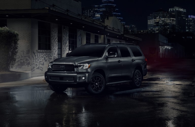 The front and side image of a black 2021 Toyota Sequoia.