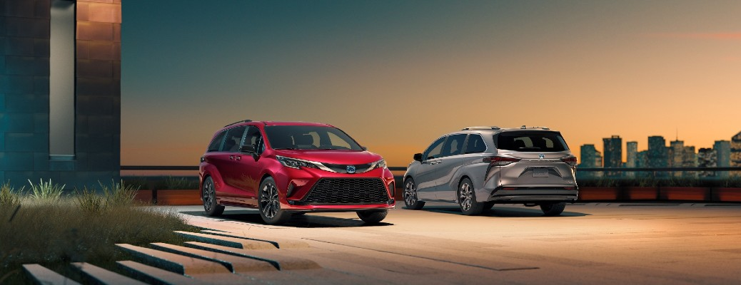 The front and rear view of a red and a silver 2021 Toyota Sienna.