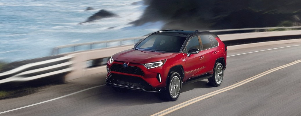 The top and front view of a red 2021 Toyota RAV4 Prime.