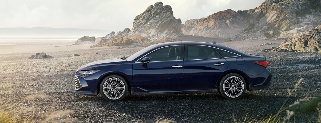 The side view of a dark blue 2021 Toyota Avalon with AWD.