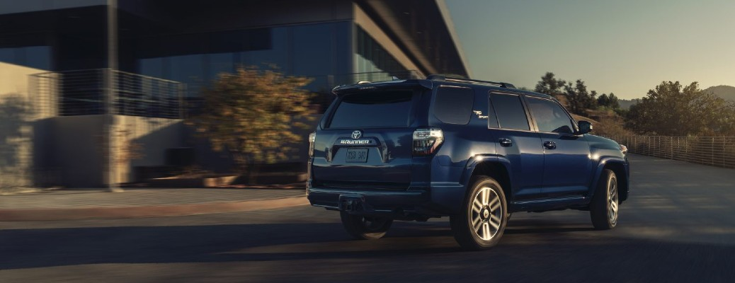 The rear and side view of a dark blue 2022 Toyota 4Runner TRD Sport.