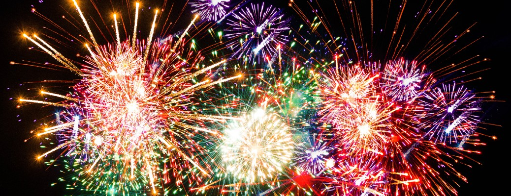 Many colorful fireworks being displayed on the Fourth of July.