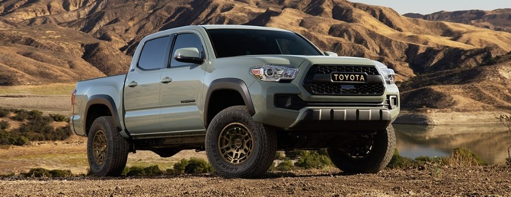 The 2022 Toyota Tacoma Trail Edition at rest amidst the backdrop of a rocky and hilly terrain