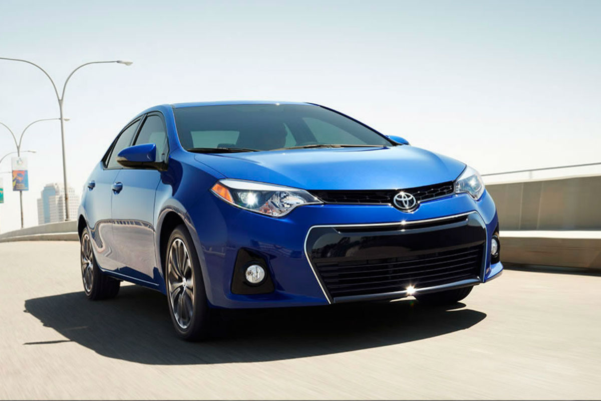Front exterior view of a blue 2015 Toyota Corolla