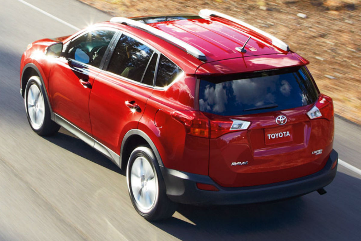 Rear exterior view of a red 2015 Toyota Rav4